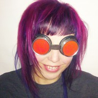 Photo: Elle Waters, in her steampunk goggles with purply hair