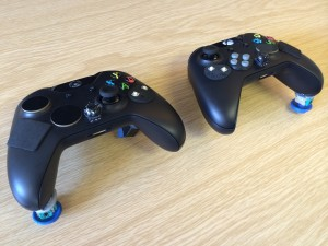 Image of two Xbox controllers, one for two-handed use, one for single-handed use.