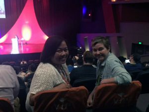 The author Julie on right and her friend Ruchi to the left in the keynote auditorium.